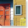 La Boca: Oddly, it's one of the least desirable neighborhoods in town but it's also the most touristy. Actually, it's only one small area of Boca that has found its way into practically every book's photograph of Buenos Aires. I do think that the picturesque small street of Caminito is a tourist trap (and the tour buses lined up there seem to prove it). The colorful street was the idea of artist Quinquela Martin, whose paintings I think are superb. His nearby house and studio are now a museum of his works and should definitely be visited.